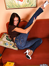 Energetic brunette pulls off her hot jeans to show her lace white panties