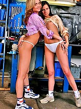 Two lesbian girls playing with their panties at auto repair shop