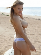 Viola O teases out of her clothes on the beach and demonstrates off her large, natural boobs.