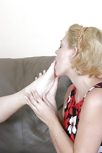 Magnificent Vixens Licking And Foot Banging On The Couch