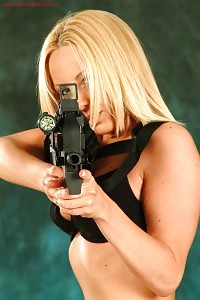Clair Louise Looking Inviting With Her Gun