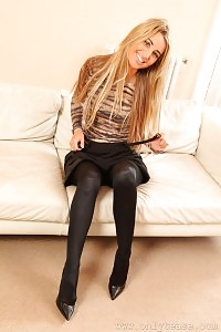 Awesome Light-haired In Black Shiny Hose